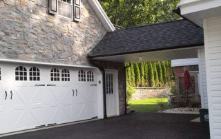 White home with connected garage
