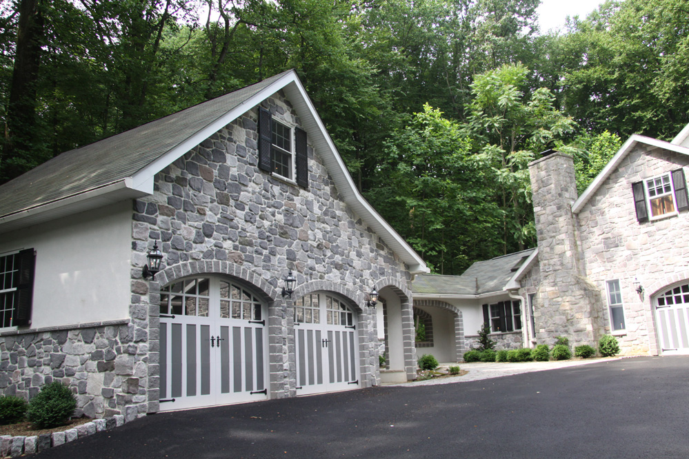 stone home and garage