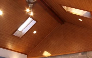 white home interior wood ceiling