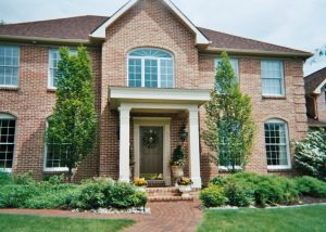 brick house with white columns