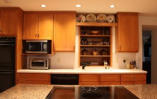 white kitchen with light wood cabinetry