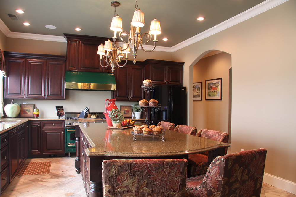 kitchen with dark wood cabinetry with wood island