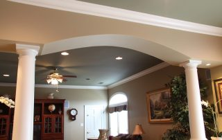 light colored ceiling and arch