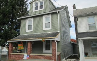 House with green siding